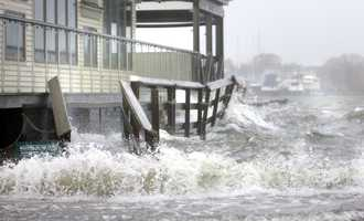 Waves crash against homes on Plum Island