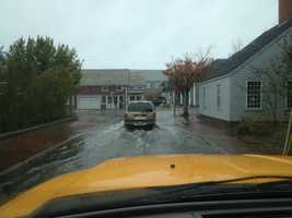 Street flooding in downtown Nantucket at high tide.