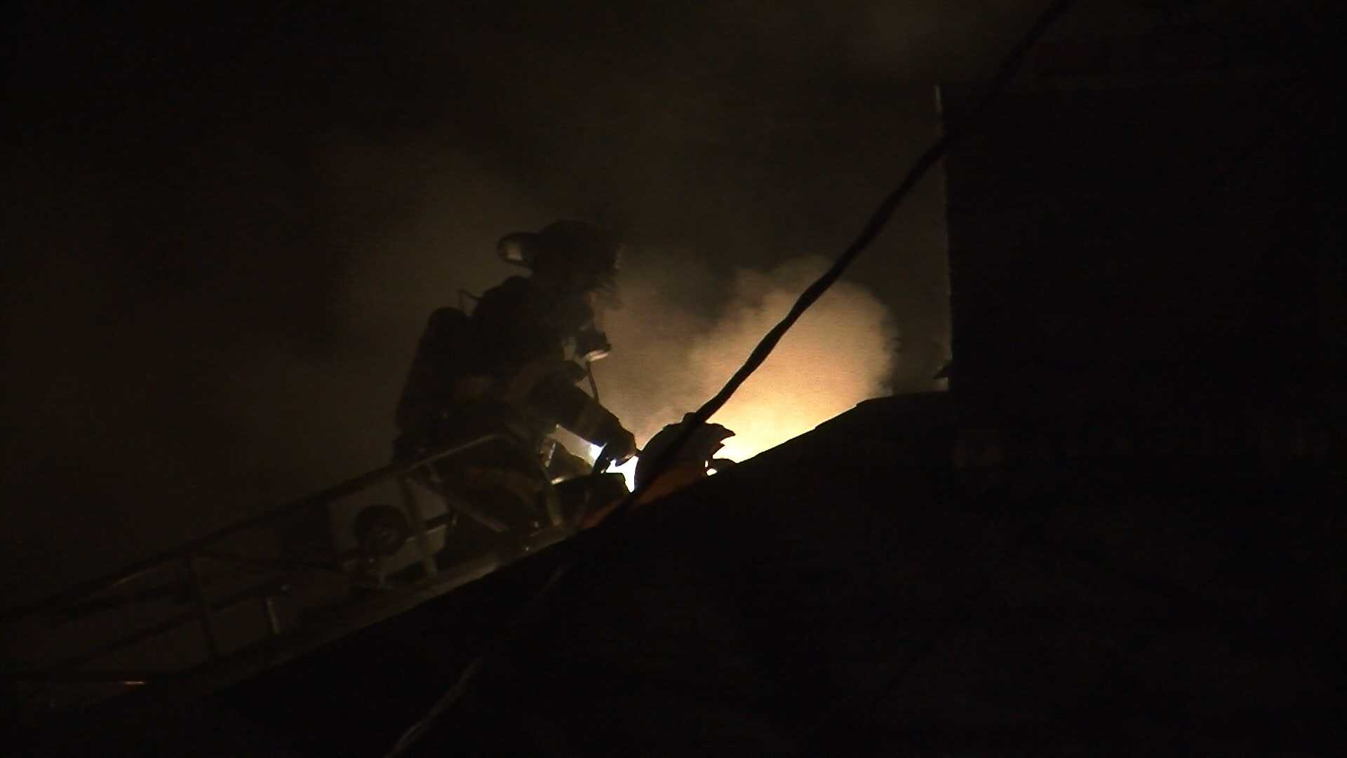 Crews fight house fire by university - IMG