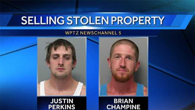 2 arrested in sales of stolen electronic devices