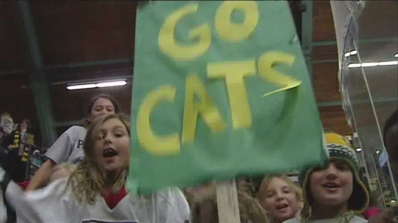 The lady cats hockey team gets more than 2,000 fans to the game to help Meals on Wheels.