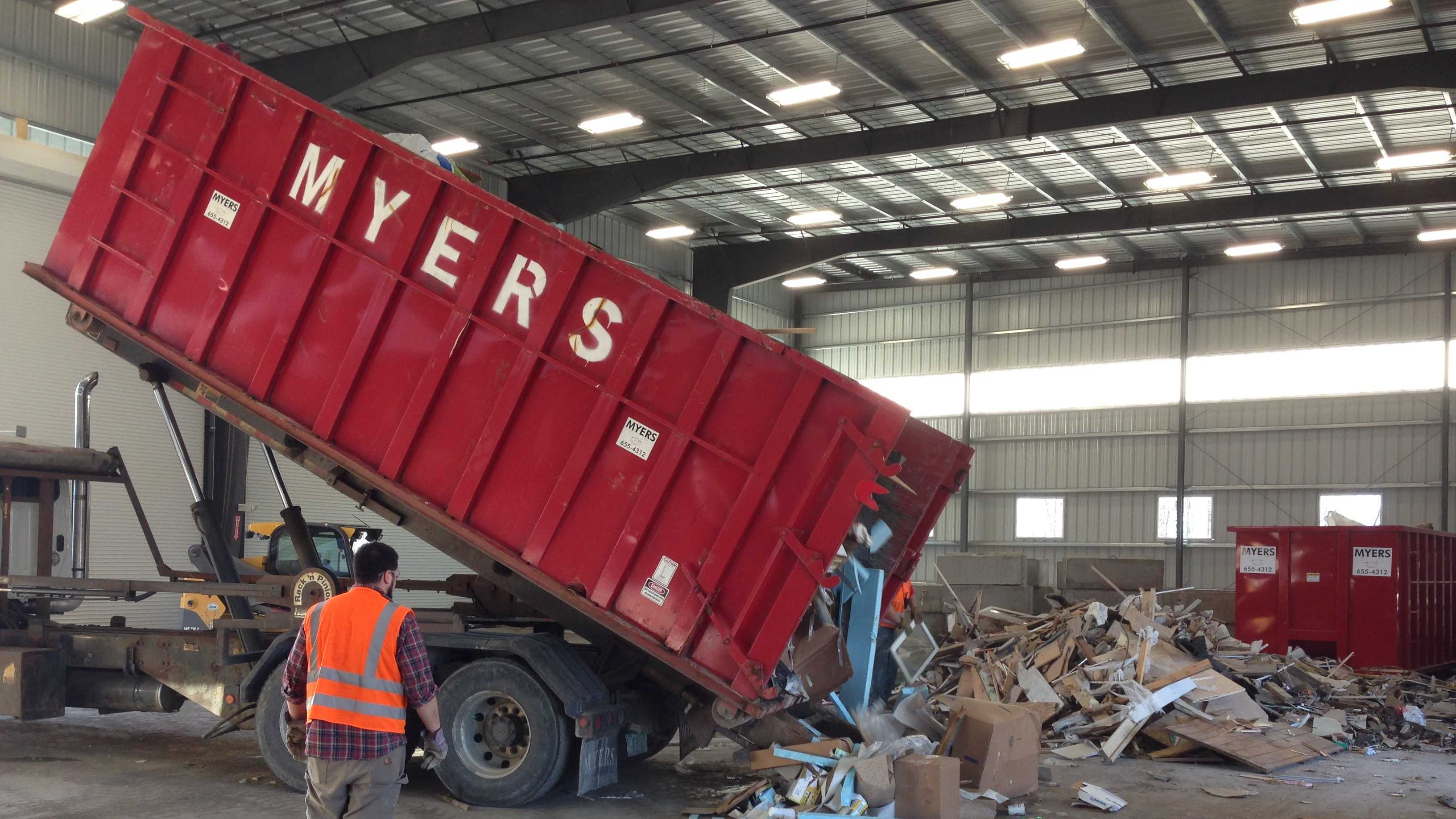 A three-ton load of construction debris from Burlington arrives at Myers Recycling Center Monday afternoon.