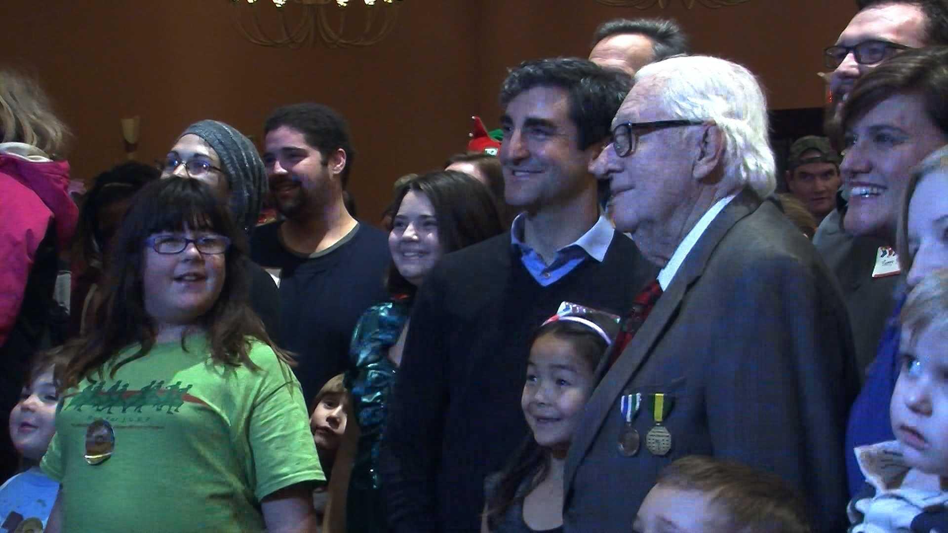 12-8-13 Hundreds of families celebrate holiday season - img