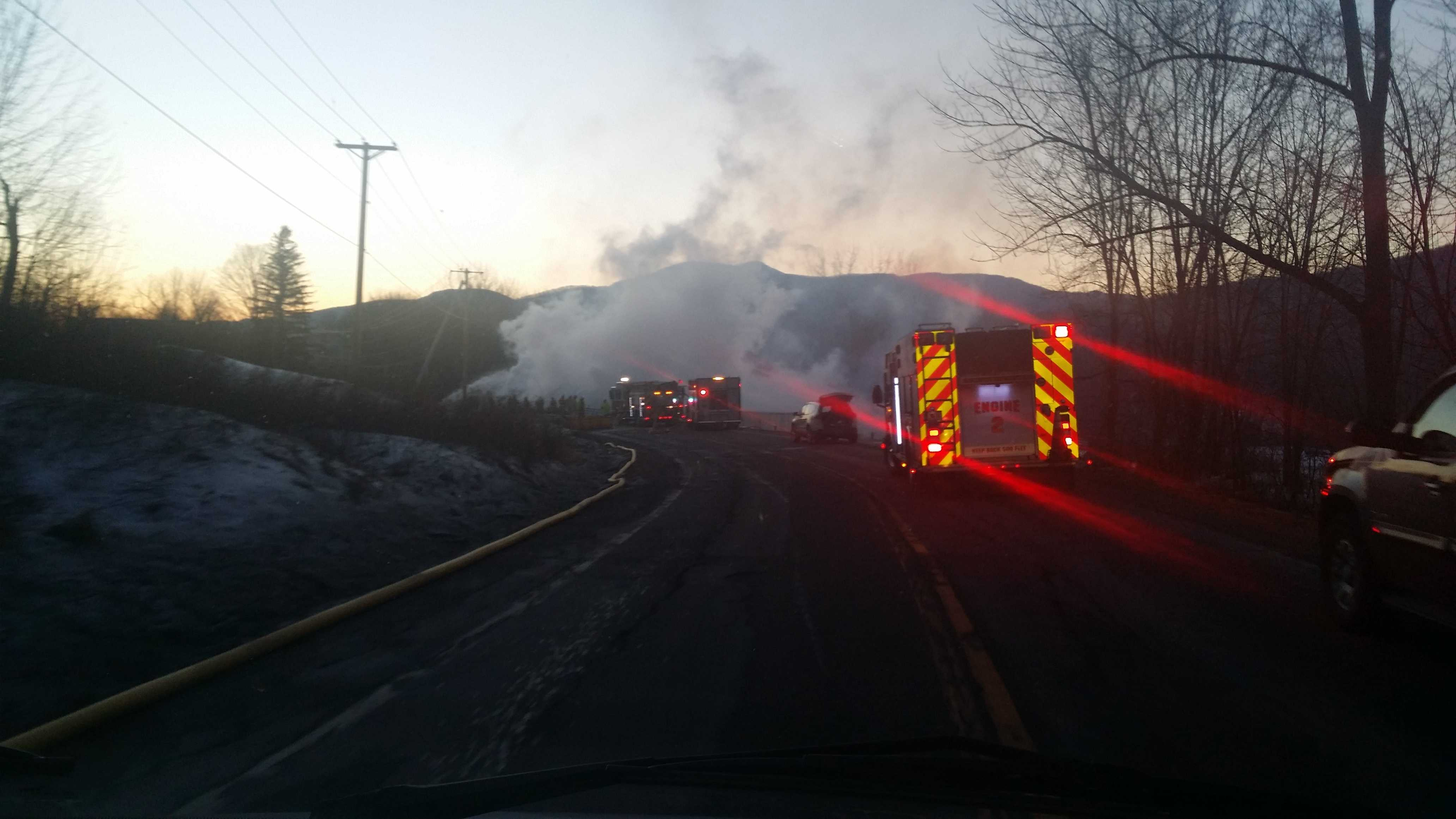A Vermont road has reopened after it was closed twice, first for flooding, then for a barn fire.
