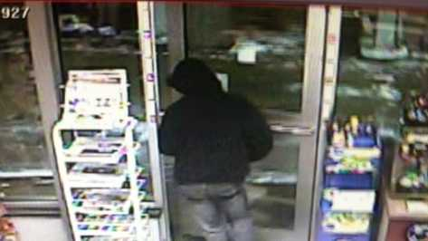 1-20-14 Man shows knife, demands money at gas station - img