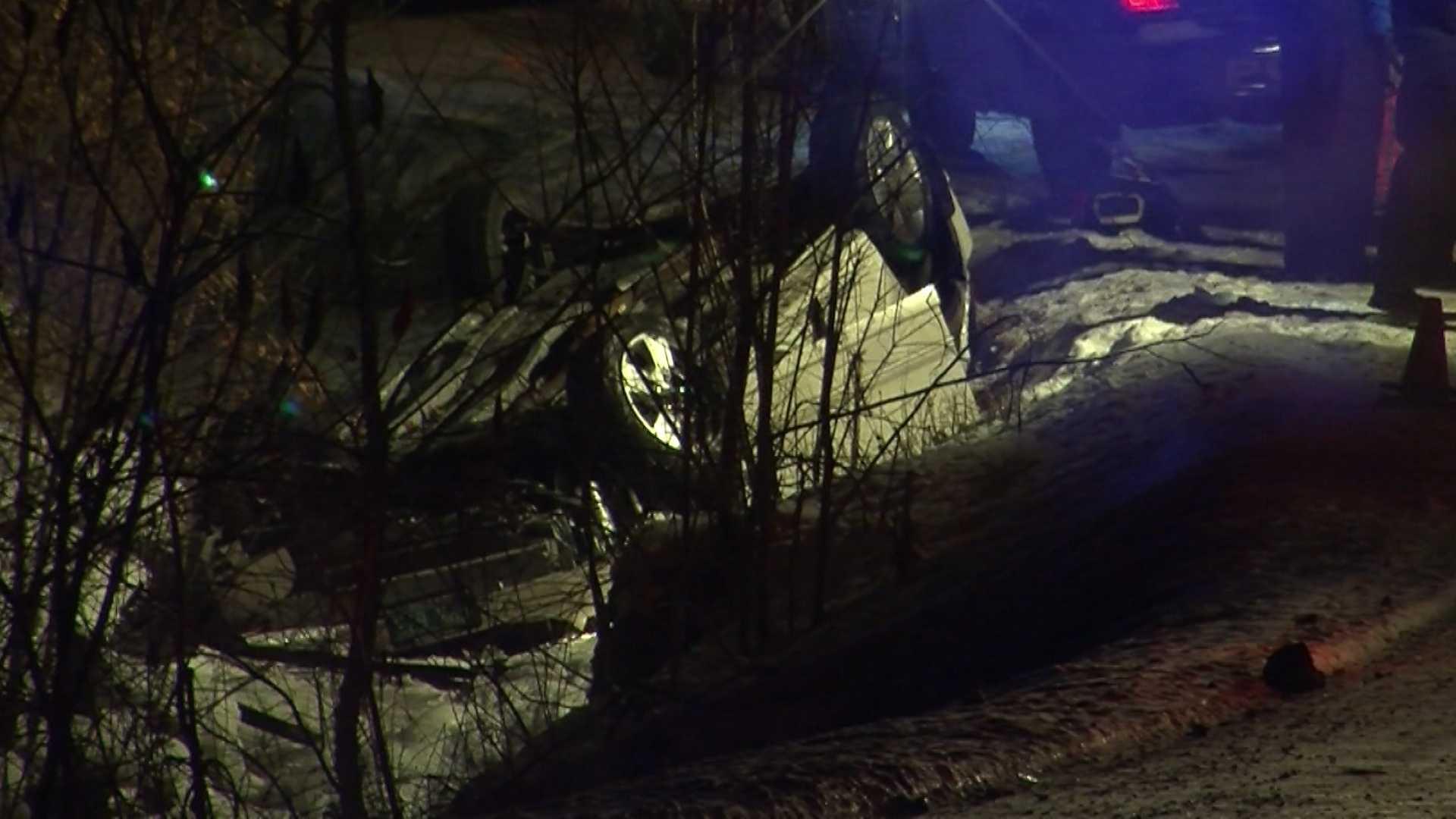 1-23-14 Car rolls into creek, 1 taken to hospital - img