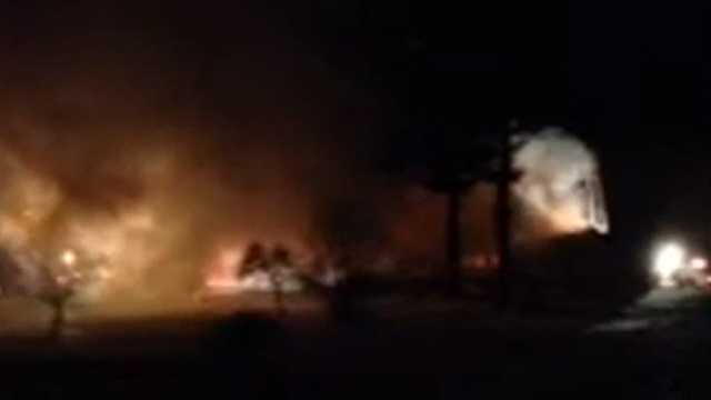 Raw video Crews battle fire in Port Kent