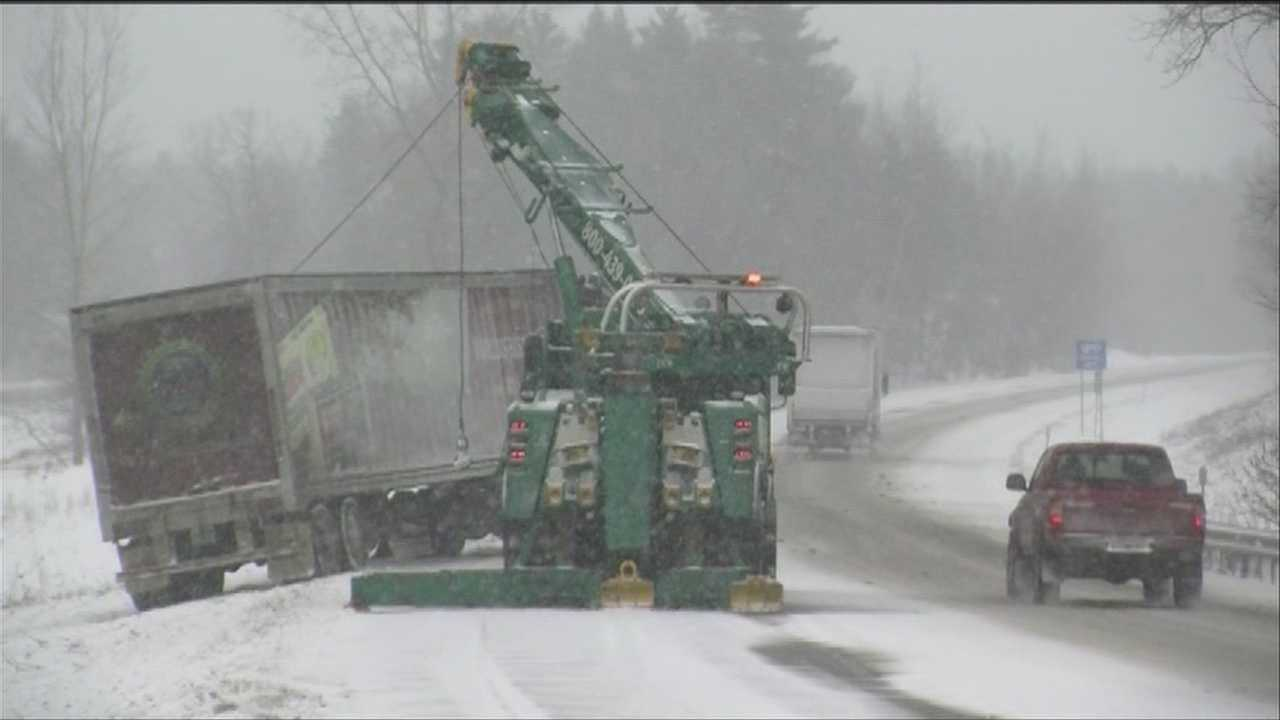 The late-winter nor'easter made travel tricky Wednesday as snow piled onto the roads and airlines canceled flights.