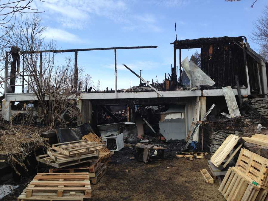The burned out shell of a South Hero home that was destroyed by a late-night fire Wednesday, April 9, 2014.