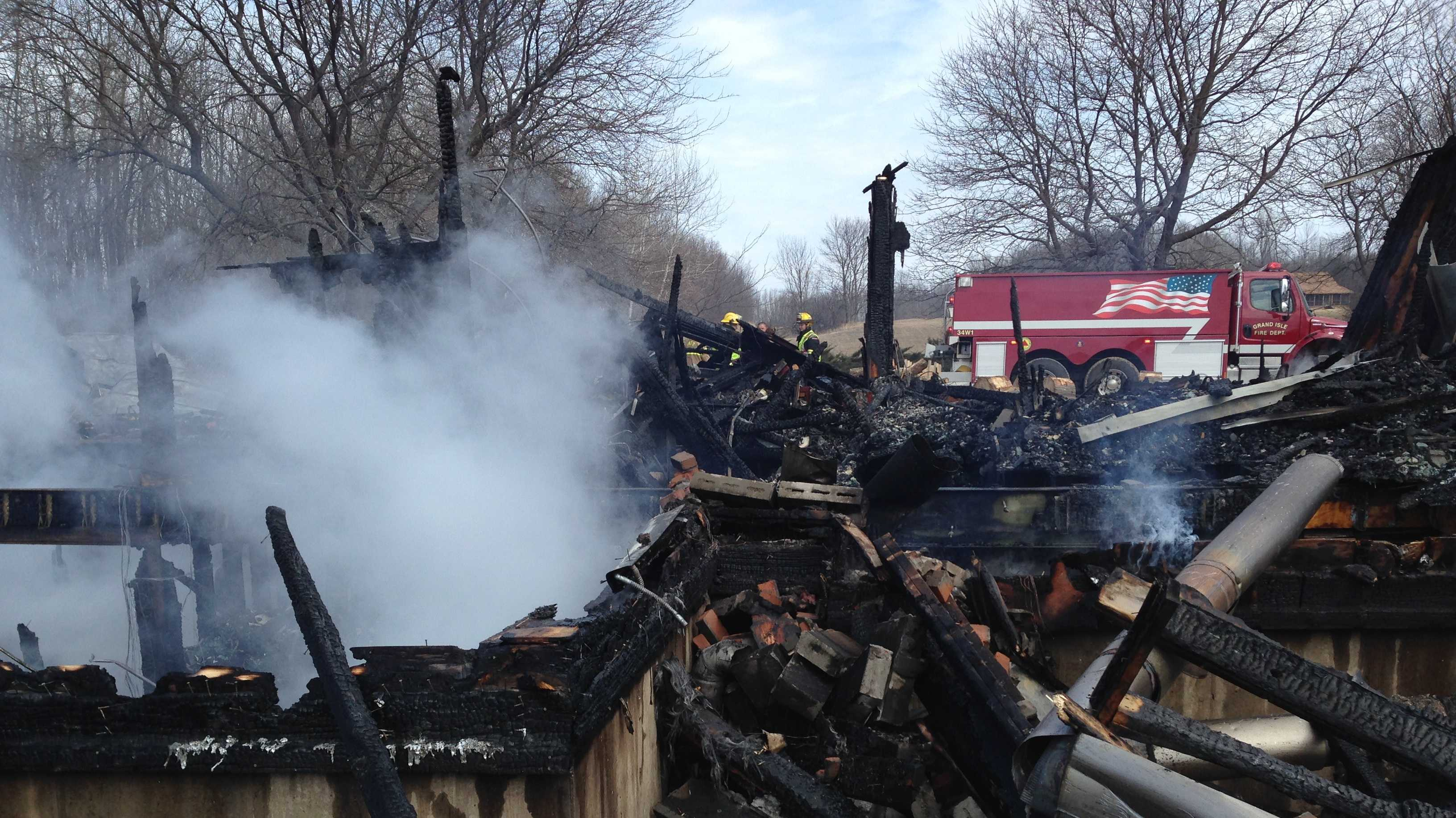 Smoke rises from the ashes of a South Hero home destroyed April 9, 2014 by fire.