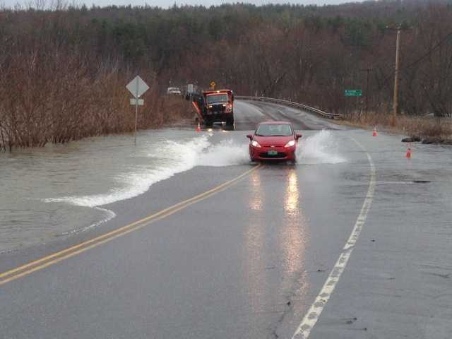 A car drives over Route 15 in Cambridge, Vt.