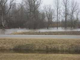 The Great Chazy River overflows its banks along Perry Mills Road in Champlain, N.Y.