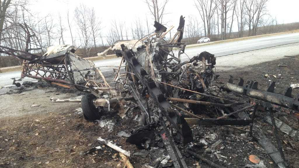 Burned out remains of a plane that crashed on Interstate 89 Friday afternoon in Highgate, Vt.