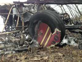 Burned out wreckage of a plane that crashed Friday afternoon on Interstate 89 in Highgate, Vt.