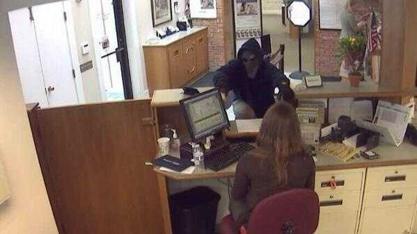 Police investigating bank robbery - img