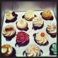 A dozen cupcakes from My Little Cupcake.