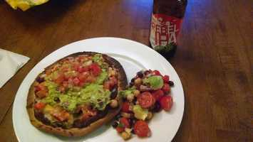 Hayley's Homemade Mexican Pizzas with a Fiesta Bean Salad:Mexican Pizza is a baked tortilla layered with refried black beans, then tomatoes, red peppers, onions and cheese. After broiling for a couple minutes, I pulled it out and topped with homemade guacamole and Pico de Gallo. The Fiesta bean salad was also homemade, with black beans, chickpeas, cherry tomatoes, onion, cilantro, lime juice and cumin… topped with some avocado chunks. Sam Adams Rebel IPA tasted SO good with all of this.
