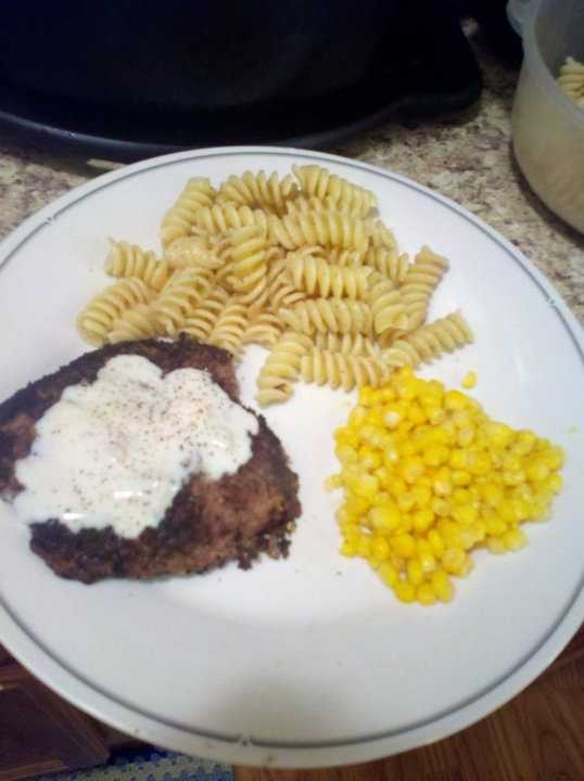 Country fried steak with gravy, buttered pasta and corn! Good eats, says Jeremy.
