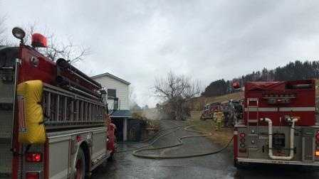 A fire burned Sunday on Mount Pleasant Street in St. Johnsbury, Vt.