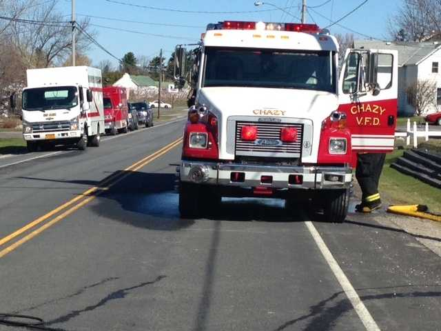 New York fire officials are investigating the cause of a house fire in Chazy. A section of Route 9, near the house, was closed briefly because a hose had to be run over it.