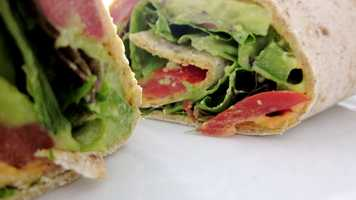 I eat a lot of sandwiches/wraps!! This one is an Ezekiel wrap, roasted red pepper hummus, tomatoes, spinach, green peppers and avocado.