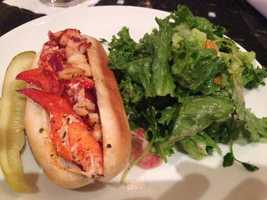 Lobster roll at Blue in the Marriott. Sinan says this hot butter roll with lots of lobster, accompanied by a fresh salad is, simply put, delicious.
