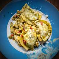 From Abby's kitchen: Homemade spinach and feta pierogies with pesto, roasted red peppers, artichoke hearts, and, of course, feta.