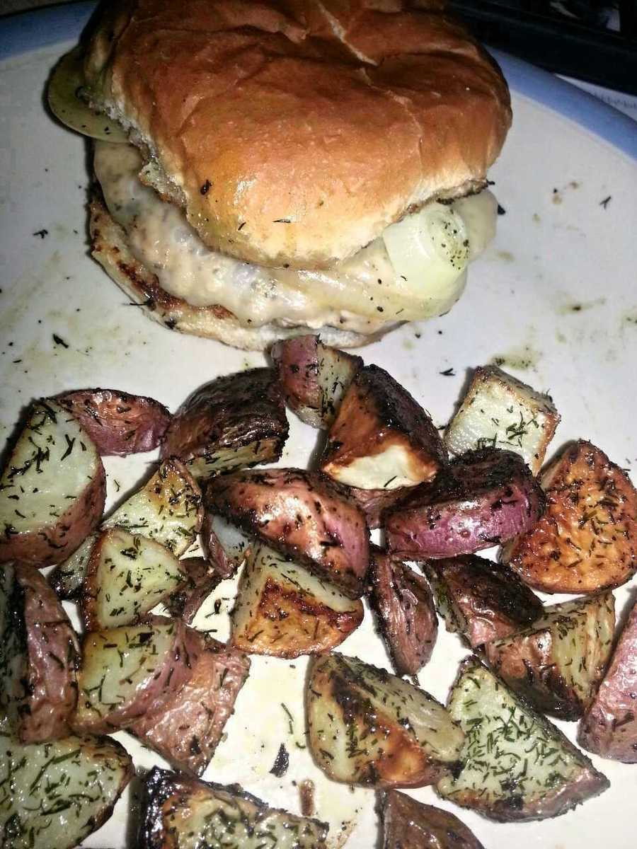 A grilled turkey burger topped with grilled onions and provolone. Served with a side of mostly-cooked red potatoes seasoned with dill and garlic. (Tasty AND photogenic this time!)