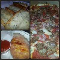 Cheese garlic bread, a ricotta calzone with pepperoni and tomato and a meaty pizza from Angelina's in Cambridge, Vt. Angelina's is absolutely my favorite pizza place in the universe! - Web Editor Jen