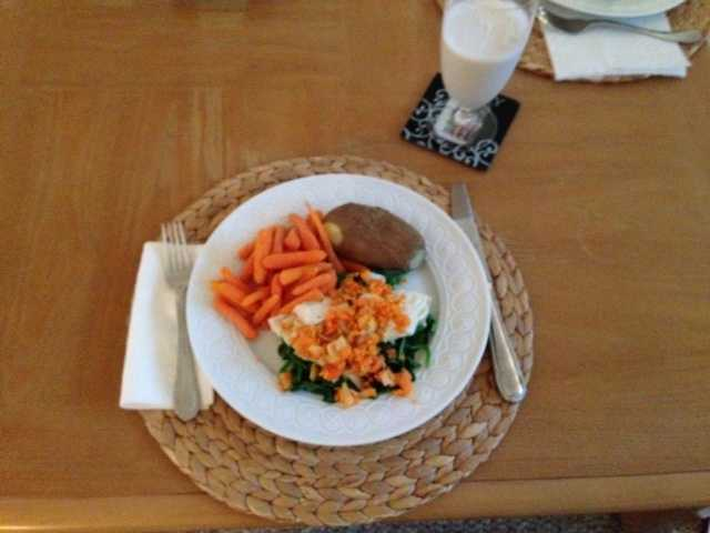 Seared cod with carrot-almond dressing on a bed of wilted spinach and a side of steamed carrots and a baked potato (inspired by a Real Simple magazine recipe). - Alison Carey, reporter