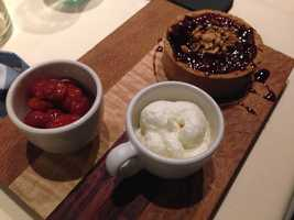 Raspberry tart with fresh whipped cream and cherries from Juniper. This was my husband's dessert and obviously, I had food envy and insisted I get a taste. - Bridget Shanahan, anchor
