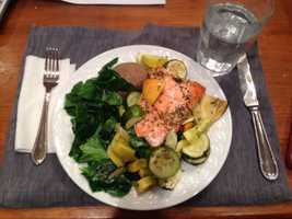 Roasted lemon oregano salmon with zucchini and summer squash with collard greens and a baked potato. - Alison Carey, reporter