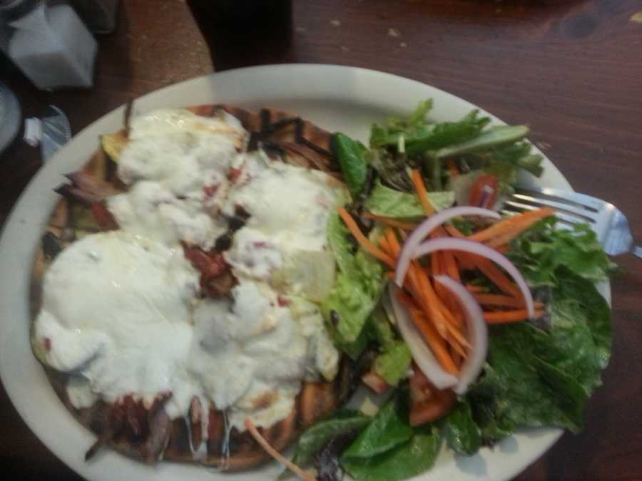 A roasted veggie flat-bread topped with mozzarella and served with a fresh salad drizzled with a balsamic dressing from 158 Main in Jeffersonvill, Vt. - Web Editor Jen