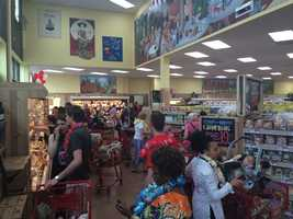 Opening morning shoppers browse the shelves of Trader Joe's.