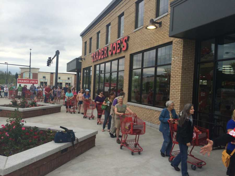 Shoppers wait in a very long line to get into the newly opened Trader Joe's.