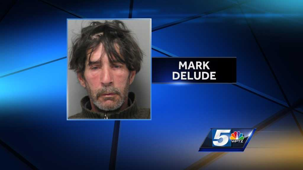Mark Delude seen in an April 2014 booking photo.