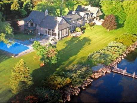 For $2.6 million, you can buy this 2-story, 9,000 square foot Shelburne, Vt. home located right on the bay. It offers 9.7 acres with a pool, hot tub, dock, large lawns, and four terraces. It has 5 bedrooms, 6 baths, a 6-car garage and easy access to your sandy beach, dock, and boat mooring.