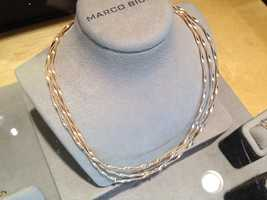 This gold and diamond necklace is valued at $10,000. You could buy 300 and give them to your closest friends.