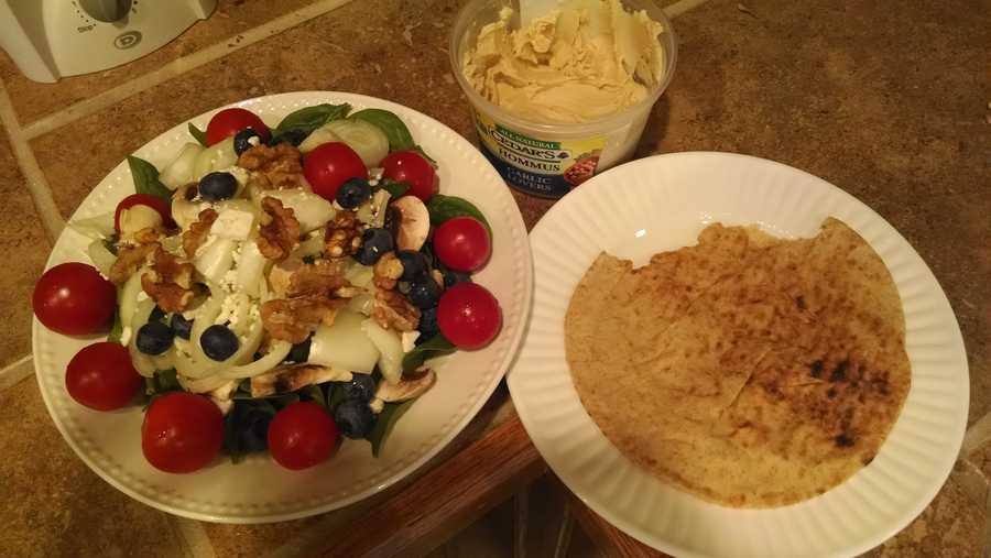 This was my lunch one day this week. A massive salad- with spinach, tomatoes, onions, mushrooms, blueberries, walnuts and a little feta cheese. I also love hummus, so I dipped a few tomatoes and pita in that. - Hayley Lapoint, meteorologist