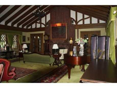 Handhewn beams, Heavy Molding, Wrought Iron Hardware, Oak and Brick flooring, an Antique wood cooking stove, and a Soaring Stone Fireplace are some examples of the authentic turn of the century craftsmanship.