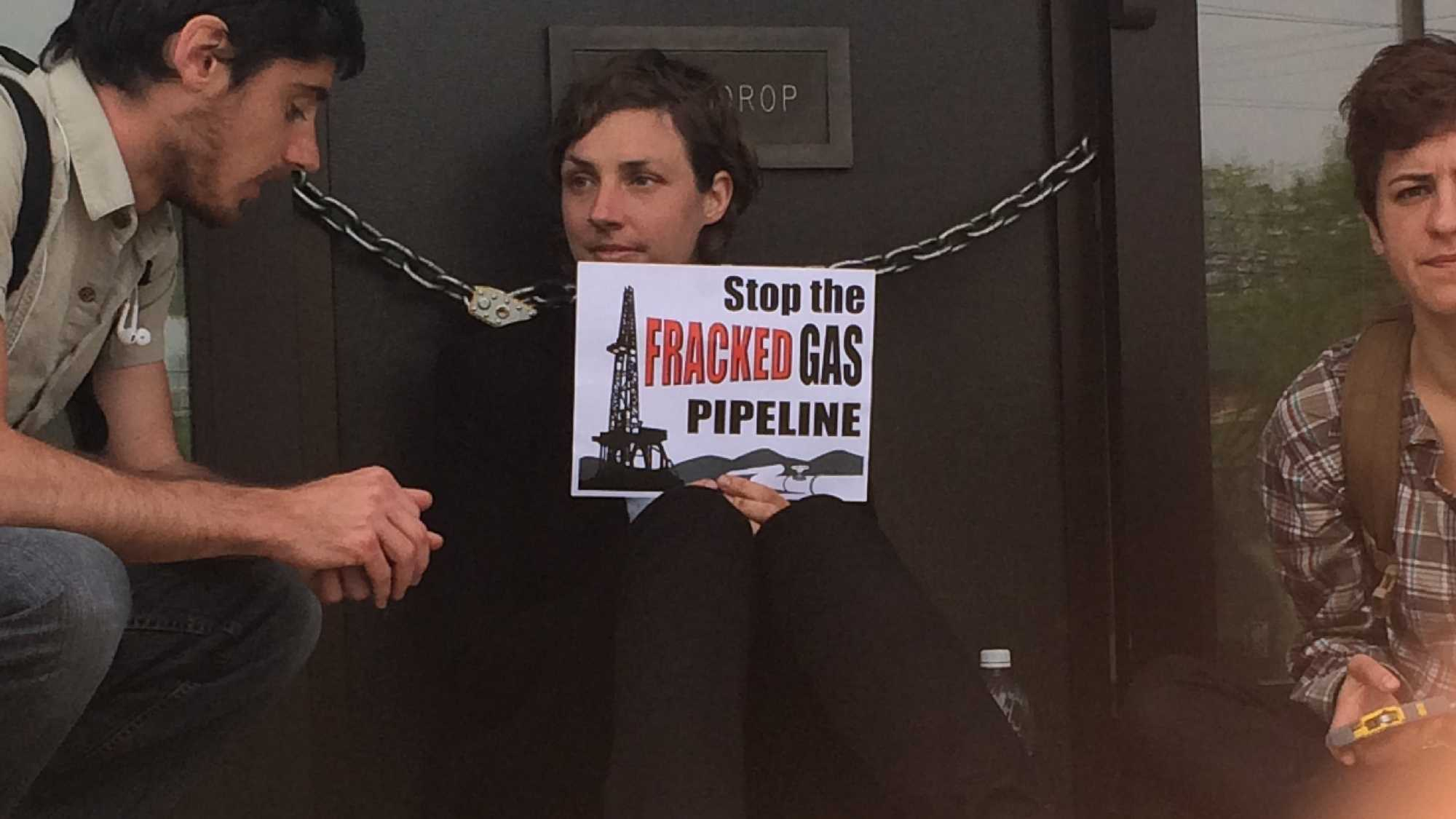 Sara Mehalick, of Plainfield, Vermont, chained herself to the main entrance of the Vermont Gas building in protest of the company's pipeline plan.
