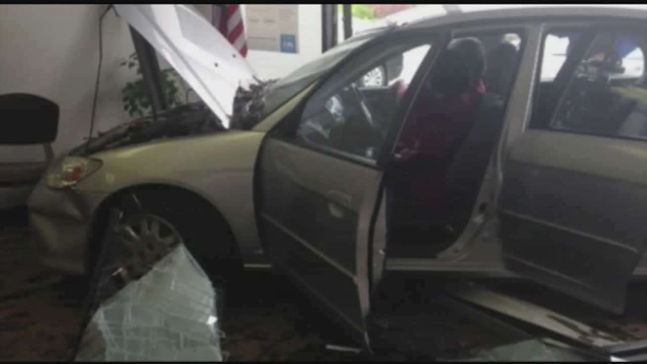Car crashes through doctor's office wall