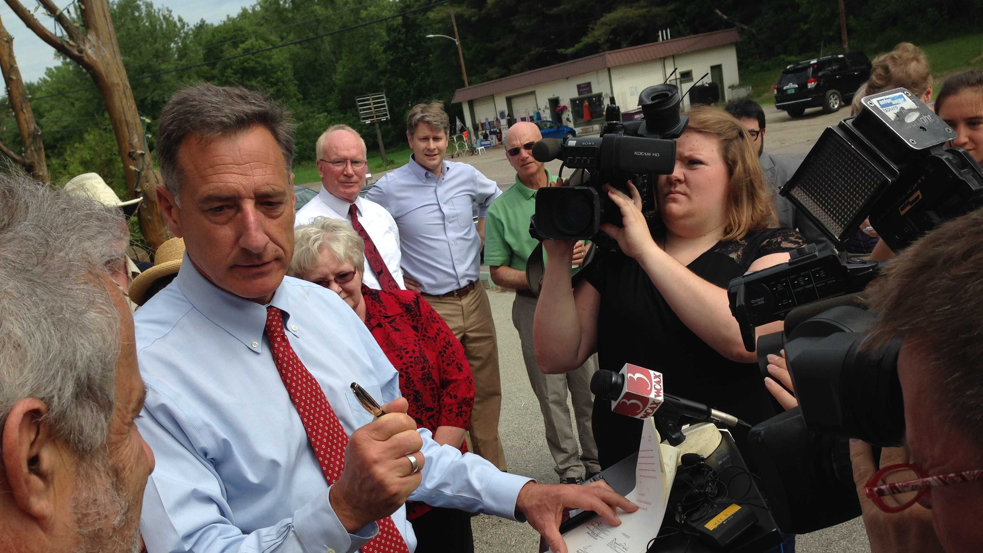 Gov. Peter Shumlin signing the minimum wage increase bill into law.