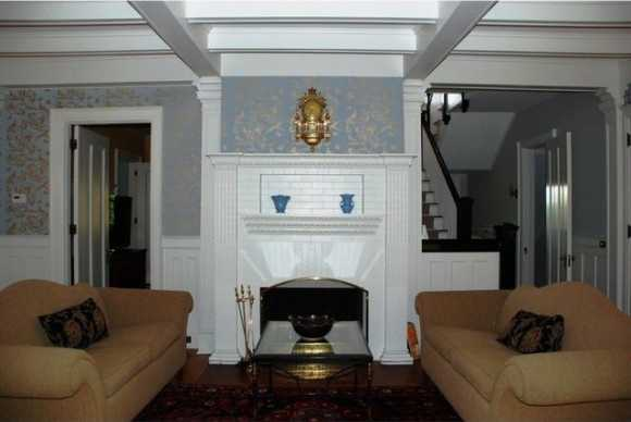 The fireplace/mantle is the focal point of the formal living room.