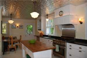 The spacious kitchen also includes a sweet eat-in kitchen.