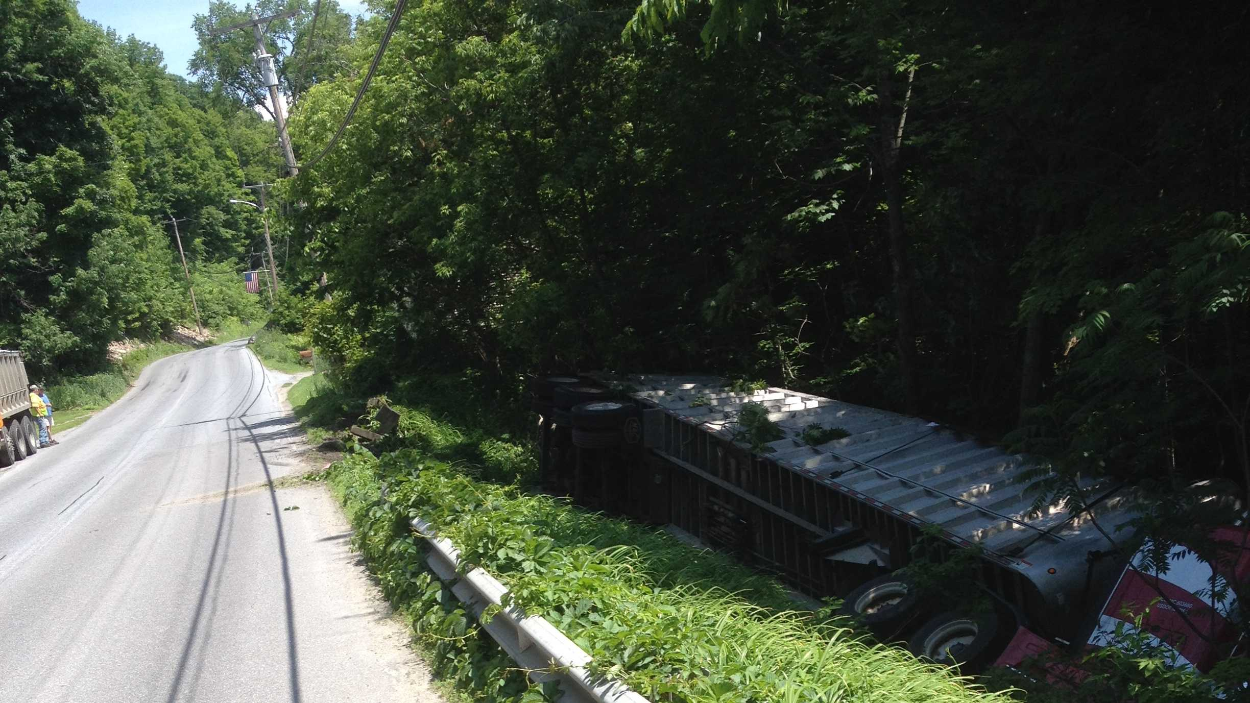 A tractor-trailer crashed through a guardrail on East Street in Bristol and rolled over Tuesday afternoon.