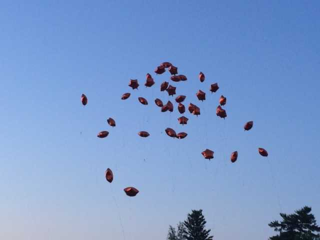 Letting the balloons go in memory of Taoufik and Mike