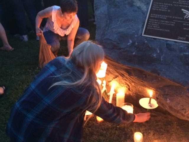 Brightening the lights around the memorial rock.
