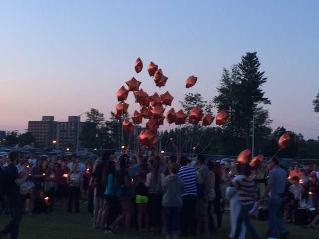 Letting the orange balloons go. Flying away.