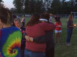 Friends sharing a hug as they share the loss of friends who are gone far too soon.